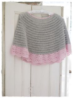 Just this pic. Start with round neck.  Drops.   Think on this one.  Poncho