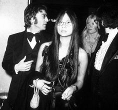 John Lennon Is Pictured With His Personal Assistant May Pang A Beautiful Woman In
