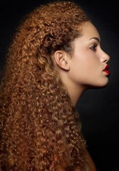 Long kinky curly red hair with pulled back sides hairstyle