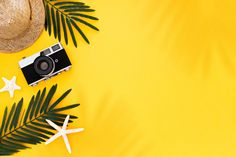Flat lay with traveler accessories: tropical palm leaf, retro camera, sun hat, starfish on yellow background Free Photo Wallpaper Powerpoint, Powerpoint Background Design, Background Design Vector, Leaf Background, Yellow Background, Background Patterns, Vector Design, Design Design, Bear Wallpaper