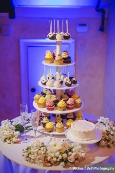 Perfectly delectable tiers of cupcakes at the perfectly elegant McClanahan & Elliott wedding | Photo credit Richard Bell Photography #weddingcupcakes