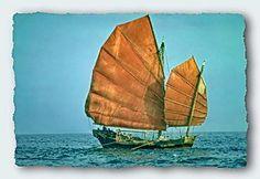 CHINESE JUNK BOATS   Chinese Junk being rowed just off Hong Kong