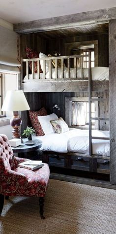 Rustic Bedroom Design Ideas - pictured: The bunk room of a Big Sky, Montana, lodge is partially sheathed in reclaimed corral boards. Markham Roberts Design : canadianloghomes --- pp: love the built-in bunkbeds.each has its own window for daydreaming.