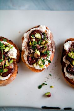 PICKLED FIG & RICOTTA TARTINES:  PICKLED FIGS:     1 dozen dried Black Mission figs, sliced into thin discs     1 cup red wine vinegar     1/4 cup sugar     1/2 cup water     3 sprigs of fresh thyme -   RICOTTA:     1 cup whole milk ricotta cheese     1 baguette, sliced into 1/4 inch rounds     olive oil     salt -  GARNISH:     1/2 cup pistachios, lightly crushed     drizzle of honey     sprigs of thyme