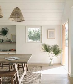 This makes my heart happy! woven basket pendant lights over dining table, palm fronds in a glass floor vase, shiplap ceiling, light wood floors, natural beachy boho tropical style