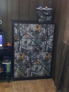 Bought dresser at Walmart.for 55.00 & bought camo contact paper. And volia!