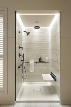 Oil-Rubbed Bronze faucetry contrasts beautifully with the neutrals of the Choreograph walls. http://www.us.kohler.com/us/Choreograph-Shower-Wall-and-Accessory-Collection/content/CNT116700120.htm?subSecId=CNT116700129