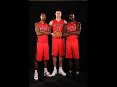 Terrence Ross, Jonas Valanciunas and Quincy Acy of the Toronto Raptors pose for a portrait during the 2012 NBA rookie photo shoot at the MSG Training Facility in Tarrytown, New York.