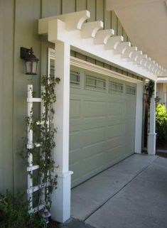 146578162845945372 Garage Door Arbor great way to increase curb appeal is with an arbor over the garage door. A manual post hole digger i. by cecelia House Paint Exterior, Exterior House Colors, Exterior Doors, Exterior Design, Diy Exterior, Garage Exterior, Exterior Makeover, Garage Door Makeover, Garage Doors