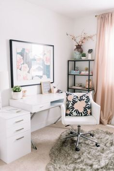 Modern Scandinavian home office in shades of pink with black and white details.