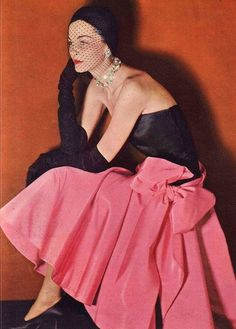 """pink skirt with huge bow reminds me of Madonna's dress in her """"Material Girl"""" video (Norman Norell 1950)"""
