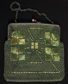 "254.	Arts & Crafts purse, Unknown maker and number, ca. 1910-1913, green floss on green fabric, satin stitch, conventional, geometric floral motif, metal clasp and chain, a rare combination of materials, color and design, 8"" x 7"", excellent condition 200-300"