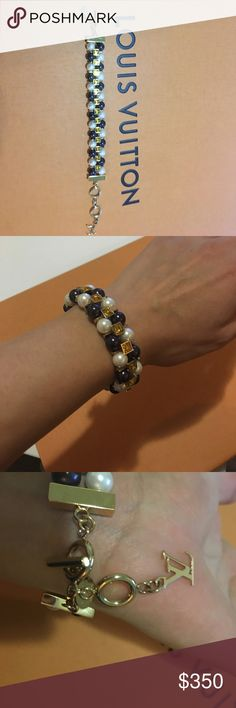 Like new Louis Vuitton bracelet. Statement cry me a river Louis collection fashion jeweler. Purple, white pearls with champagne Swarovski stone. Louis logo at the end . Very great on and picture does not do it justice.box and dust bag available at additional charge. Louis Vuitton Jewelry Bracelets