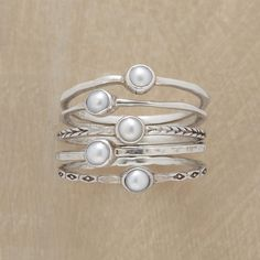 PEARL RING QUINTET, SET OF 5 -- Five cultured pearls are bezel set atop thread-thin silver bands in this pearl stack ring set, each different—polished, hammered and engraved. Handmade exclusively for Sundance. Whole and half sizes 5 to 9. Set of 5.