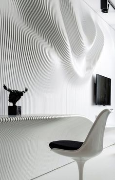 Black And White Bedroom Featuring An Intricate Wavy Wall