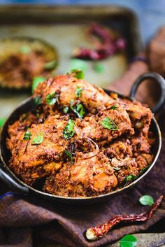 Mangalorean Chicken Sukka is a dry dish made using fresh chicken, masalas, grated fresh coconut and it is generously tempered using ghee as well as onions. #Indian #Curry #Dry #Mangalorean #Chicken