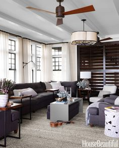 """In a Long Island, New York, beach house, designer Rob Southern covered the living room sofa in Great Plains' Weathered from Holly Hunt, """"a miracle fabric,"""" he says."""