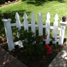 Hmmm cute idea, think I would prefer wrought iron over wood and maybe turn the fence to the outside so I can see my flowers