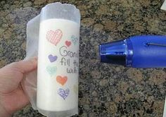 Draw on waxpaper with permanent marker, wrap around a candle, run hair dryer on it. And you have your own personalized candle