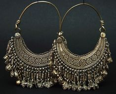 Afghanistan Silver hoop earrings from the Hazara people ca. Indian Jewelry Earrings, Silver Jewellery Indian, Jewelry Design Earrings, Tribal Jewelry, Silver Jewelry, Hoop Earrings, Silver Earrings, Silver Ring, Silver Hoops