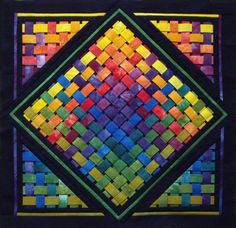 Woven Rainbow quilt.  I could make something like this with almost zero quilting.  :-)
