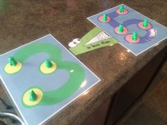 Teaching less and more with counting bears, touchmath, and greater than/less than symbols. For more Autism Interactive Teaching Ideas visit https://www.pinterest.com/evaninspired/autism-interactive-teaching-ideas/. The Greater Gator in this photo can be found free at http://www.themeasuredmom.com/less-than-greater-than-math-activity-using-toys/