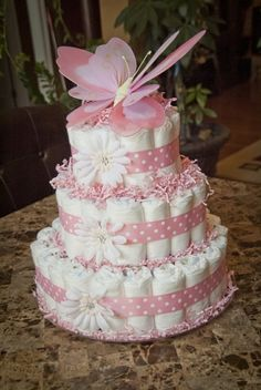 pink Baby Girl shower Diaper Cake topped with butterfly Baby Girl Shower Themes, Baby Shower Princess, Baby Shower Fun, Baby Shower Balloons, Baby Shower Gifts, Butterfly Diaper Cake, Butterfly Baby Shower, Diy Diaper Cake, Nappy Cake