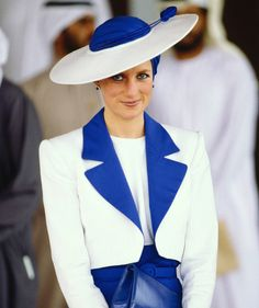 Diana topped her blue and white suit with a turban-inspired hat while touring Dubai in March 1989.