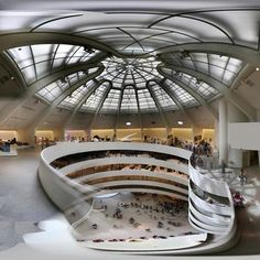 Guggenheim Museum interior, by Frank Lloyd Wright.  Huge glass dome to provide natural light for viewing art.