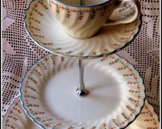 """Three tier cake stand, handmade using vintage Johnson Brothers """"Dreamland"""" pattern set of plates, """"Alice in Wonderland"""" style tea party chic Three Tier Cake, 3 Tier Cake, Tiered Cake Stands, Tiered Cakes, Patterned Cake, Large Plates, Blue And White China, Tea Ceremony, Afternoon Tea"""