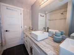 The subway tiles in the shower & the dual vanities pull it all together! Photo by Digital Video Listings.