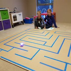 We designed a maze then, used blue tape and a large cardboard base to create it. This is our first way through the maze using scratch and the Sphero.