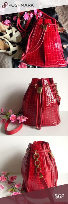 Vintage Red Leather Bucket Bag Stunning vintage Karam Handbags bucket crossbody bag, made in NYC, genuine leather, goldtone hardware and beautiful reptile print alternates in the body. Some wear on the drawstring from friction and a small spot on the bottom (SEE LAST PICTURES). I happily entertain reasonable offers 😊💕 Karam Bags Crossbody Bags