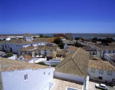 This undated image provided by the Portuguese National Tourist Office shows a view of rooftops in Faro, on Portugal's southern coast. The city's attractions include beaches, a historic walled town, and a network of walkways tiled in intricate patterns. (AP Photo/Portuguese National Tourist Office, Antonio Sacchetti)