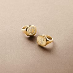 DY initial pinky rings in 18k gold with diamonds.