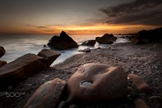 """Golden Sunset - Feel free to visit my website and see more of my works.   <a href=""""http://www.sunrisedawn.photography"""">www.sunrisedawn.photography</a>  A long exposure seascape shot of a rocky beach in Pingtung County, Taiwan on a golden sunset."""