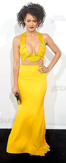 Bold and bright! The actress bared her svelte figure in a plunging yellow Cushnie et Oschs gown and accessorized with a Salvatore Ferragamo clutch and Jennifer Fisher jewelry.