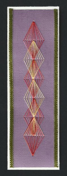 Paper Embroidery diamond pattern stitched to bookmark, red and yellow colored embroidery floss, purple card stock background