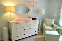 This is exactly the nursery I will be doing if baby #3 is a girl. Love the soft tones and the combination of green and pink with the blue walls.