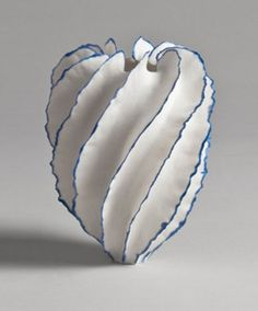 "Sandra Davolio, Born 1951 in Correggio, Italy creates porcelain tabletop objects that challenge our definition of a ""vessel"". A hand thrown porcelain core is surrounded with paper thin ""fins"" here edged with blue.... She does really unusual and curious sculptures...."