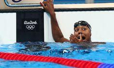 Aug 11, 2016; Rio de Janeiro, Brazil;  Simone Manuel (USA) celebrates after the women's 100m freestyle final in the Rio 2016 Summer Olympic Games at Olympic Aquatics Stadium. Mandatory Credit: Erich Schlegel-USA TODAY Sports ORG XMIT: USATSI-GRP-746 ORIG FILE ID:  20160811_jel_usa_488.jpg