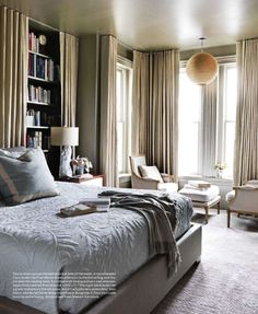 Gorgeous room, love the bookshelf wall with additional curtains...