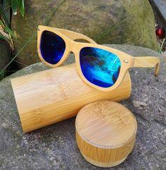 dc43cbc539 Aliexpress.com: Comprar 2016 nuevas mujeres calientes gafas de sol de madera  de bambú gafas de sol lente azul para los hombres de lujo polarizado  diseñador ...