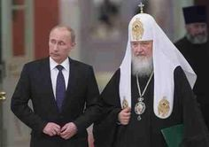 Russia's President Vladimir Putin and Patriarch of Moscow and All Russia Kirill arrive for the meeting with Russian Orthodox church bishops in Moscow February 1, 2013, in this picture provided by Ria Novosti. REUTERS/Sergei Gunyeev/Ria Novosti/Pool