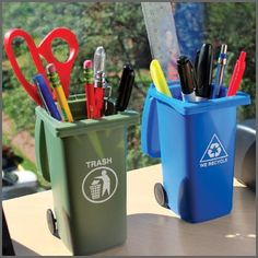 Display your desk accessories in the Trash & Recycling Mini Storage Bins Set. This set of two desktop accessory holders includes one trash bin and one recycling bin. Put your pens, pencils, and other office supplies out for curbside pickup!