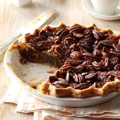 Honey Pecan Pie Recipe -Looking for a sweet ending to a special meal? This attractive pecan pie is bound to please with its traditional filling and honey-glazed pecans. —Cathy Hudak, Wadsworth, Ohio