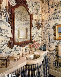Stunning! Toile wallpaper & skirted vanity + that sweet little silver sink.
