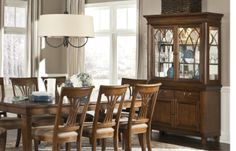 The Richmond dining set by Legacy Classic has a traditional, yet relaxed, style good for formal dining or the everyday.