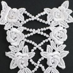 Elegant 'v' shaped heavily embroidered insert featuring a cascade of roses and embroidered lace beads . Sew on application.