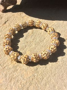 A personal favorite from my Etsy shop https://www.etsy.com/listing/252915672/shamballa-gold-bracelet